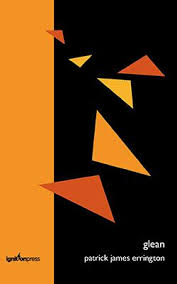 Black and orange cover with triangle shapes of orange yellow and red against the black.