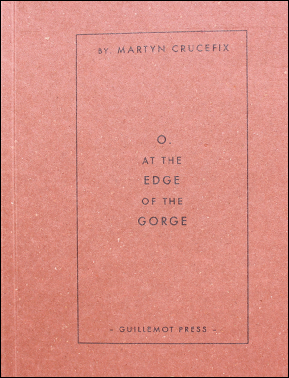 The pamphlet is A6, so relatively square. The colour of the cover is a kind of golden brown, with flecks in the paper, more golden or white. There is a black oblong in to the right of the cover and inside this at the top in small caps it reads BY MARTYN CRUCEFIX, then the main title in the centre of the box, and centred with line breaks as follows: O. / AT THE / EDGE / OF THE / GORGE. These words are all caps but O. and EDGE and GORGE are bigger. The publisher's name is in very small caps centred at the bottom of the box.